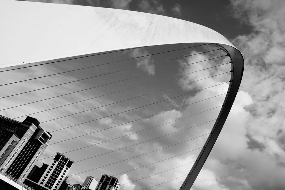 grayscale photography of concrete arch