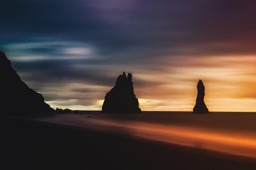 silhouette of rock formation during golden hour