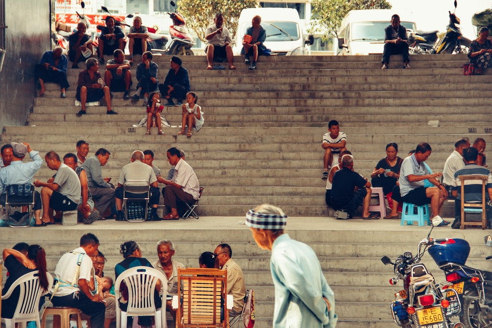 people sitting on stair during daytime