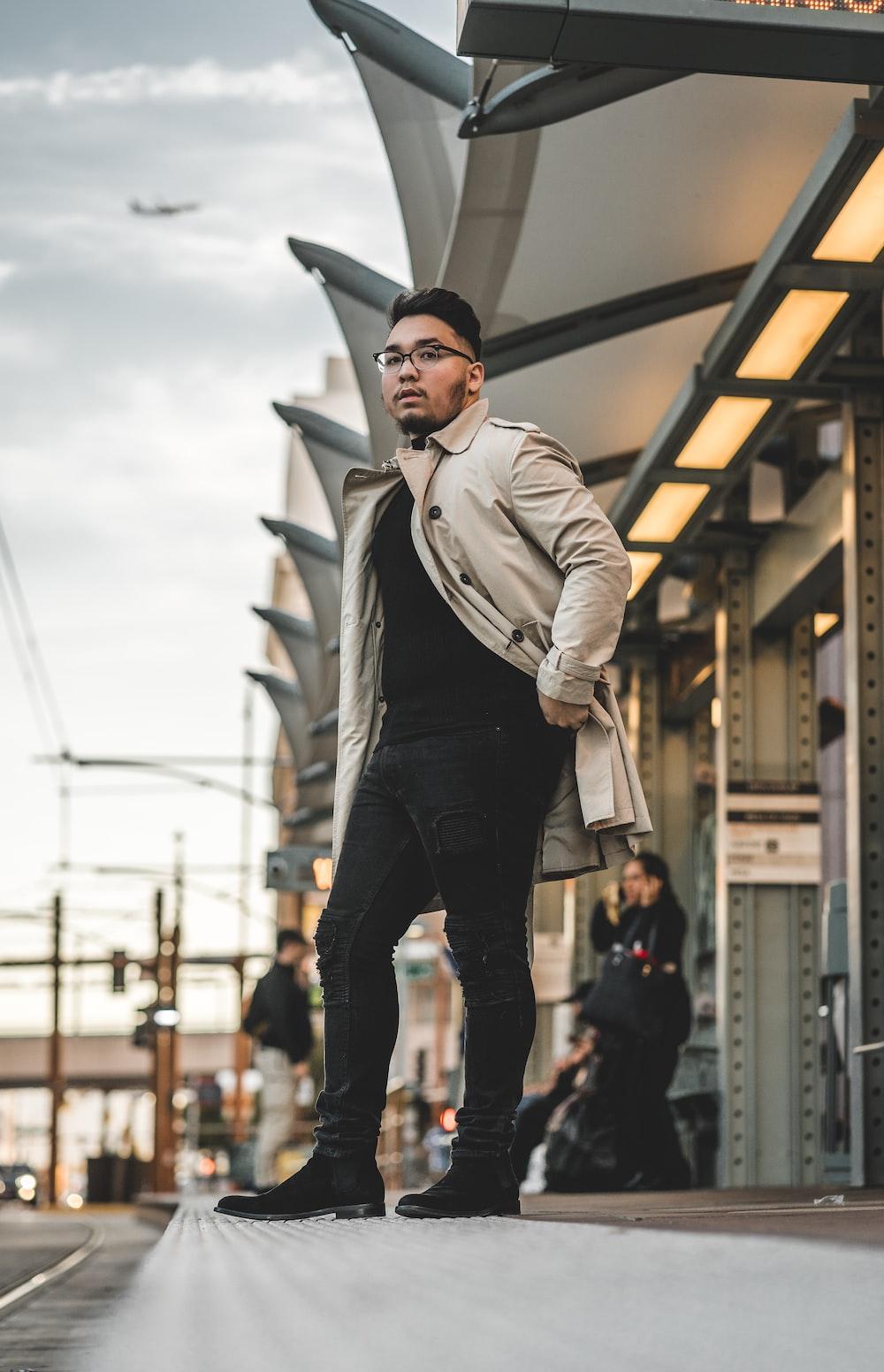 standing man wearing coat