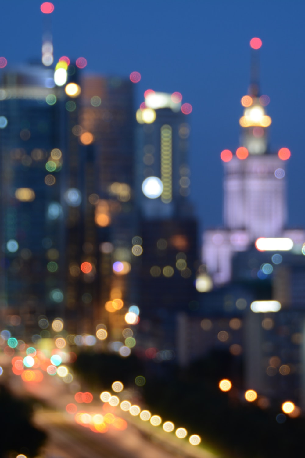 bokeh photography of high-rise buildings