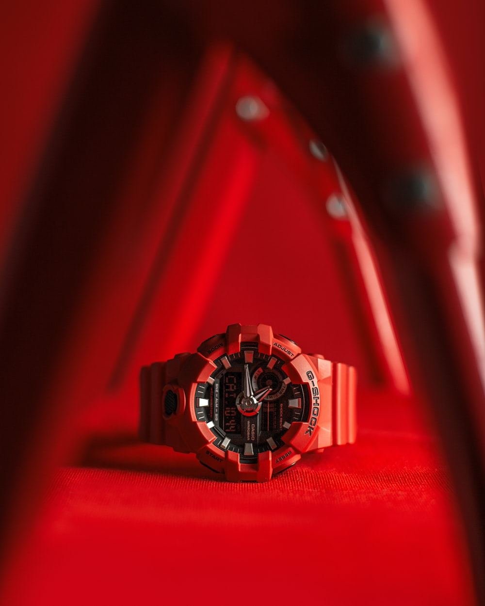 selective focus photography of red Casio G-SHOCK digital analog watch