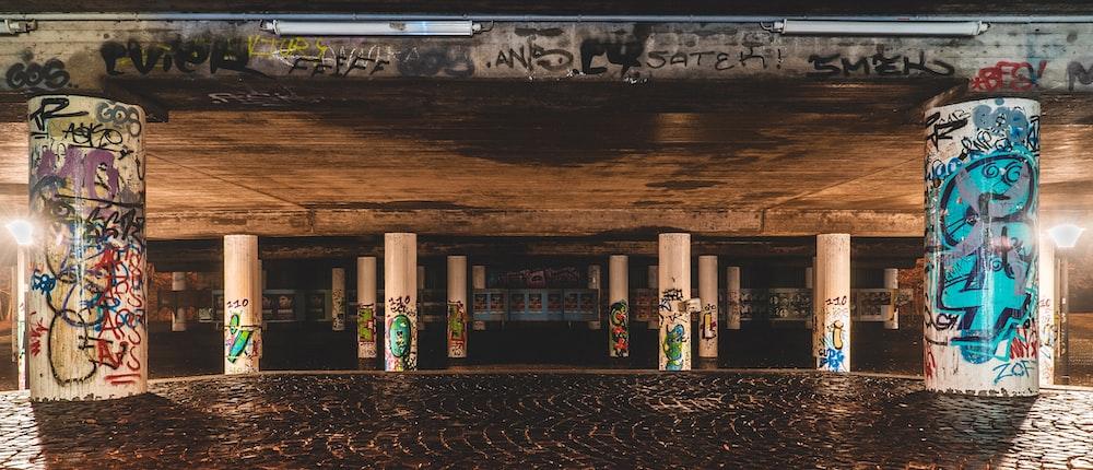 graffiti on white concrete columns