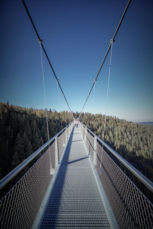 hanging bridge under blue sky