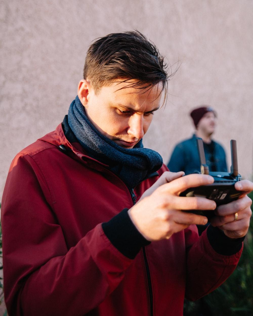 man using black camera