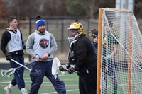 people playing lacrosse during daytime