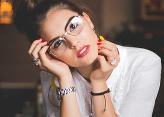 shallow focus photo of woman wearing eyeglasses