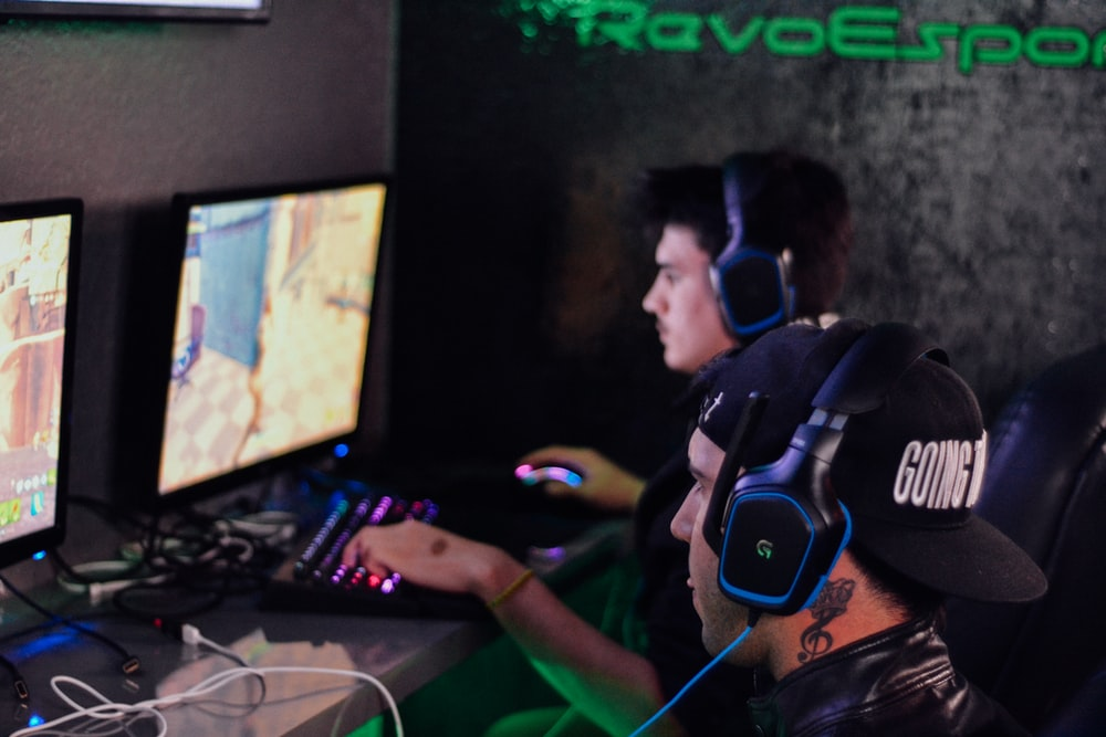 two men playing PC games