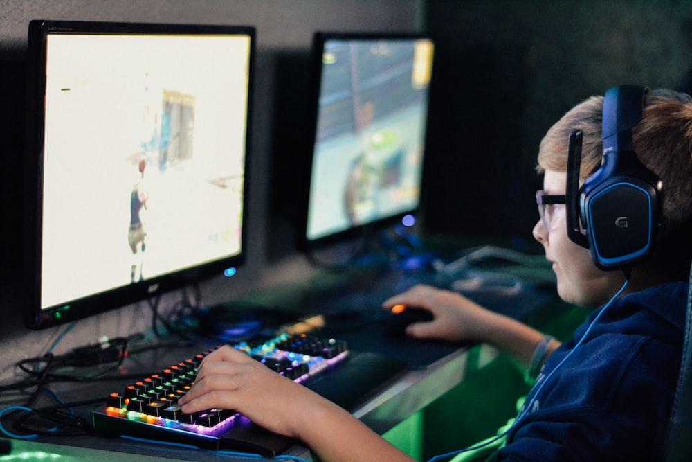 boy wearing headset playing computer game