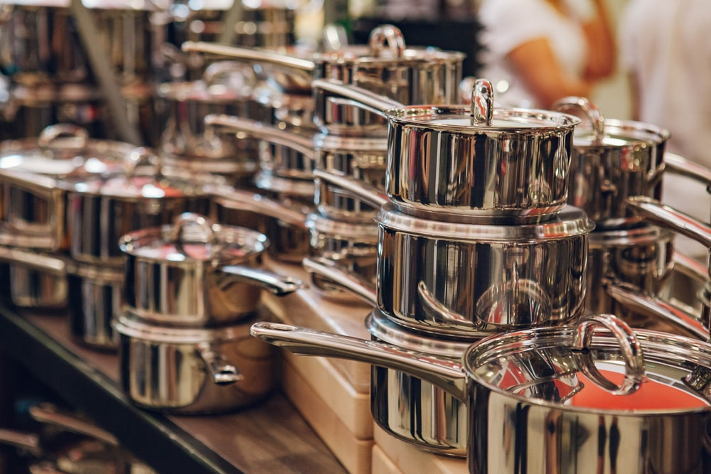 filed gray stainless steel cooking pot with handles
