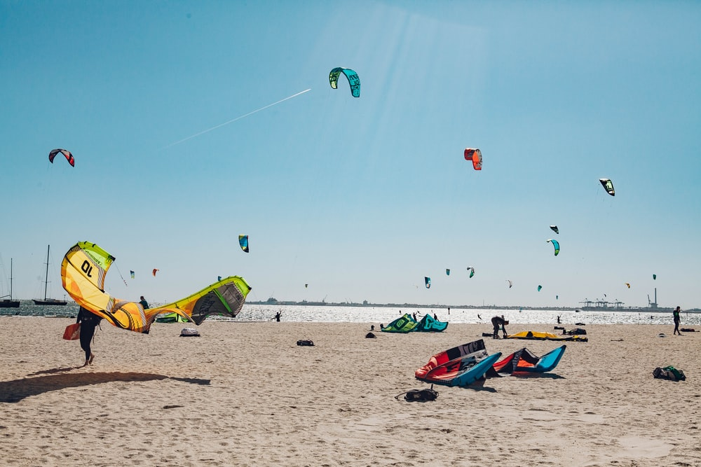 paragliders on beach