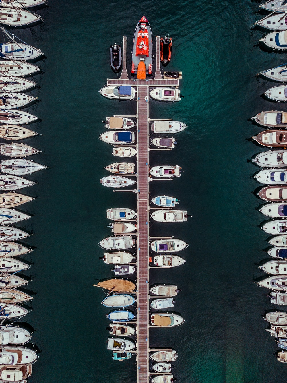 parked boats on water