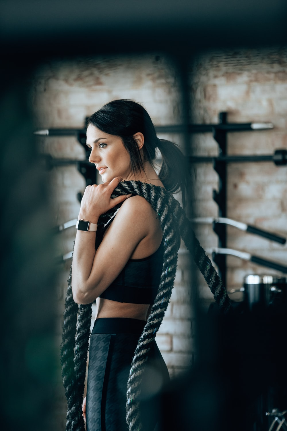 woman holding black rope