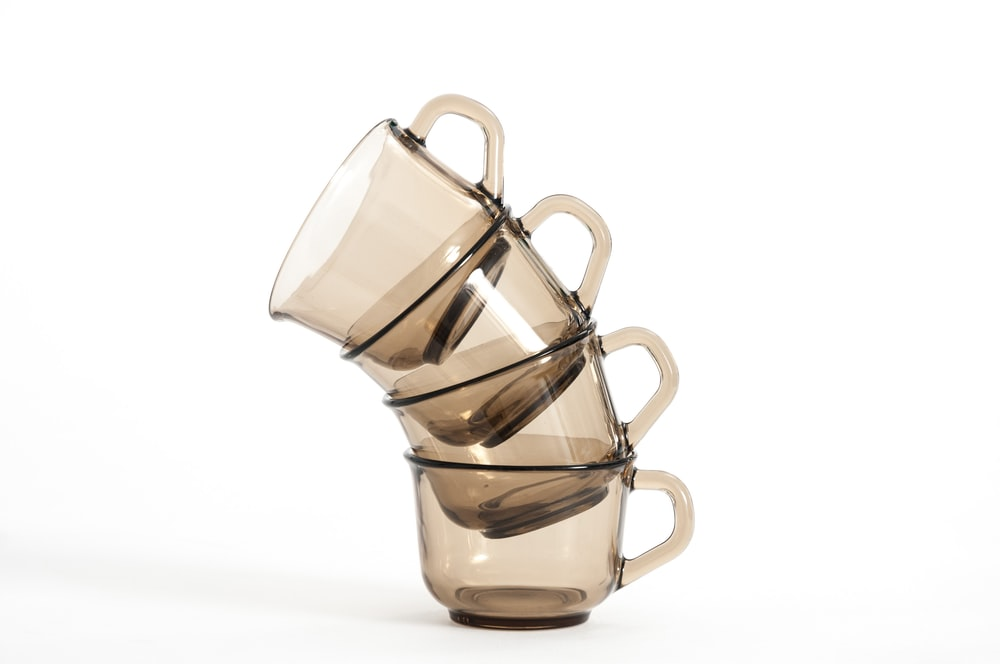 four clear glass cups