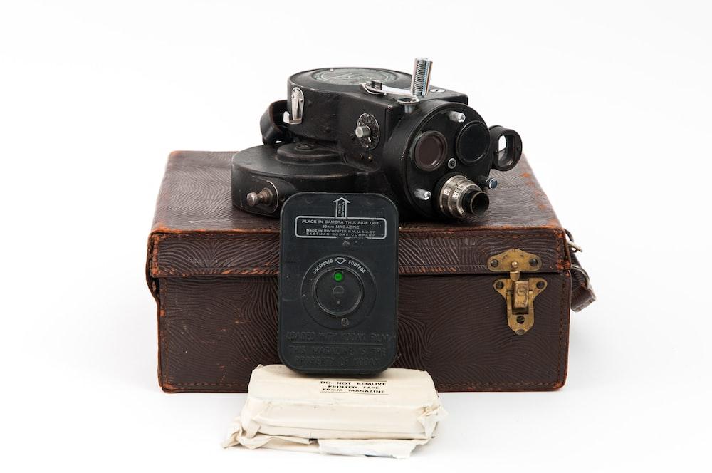 black microscope with box
