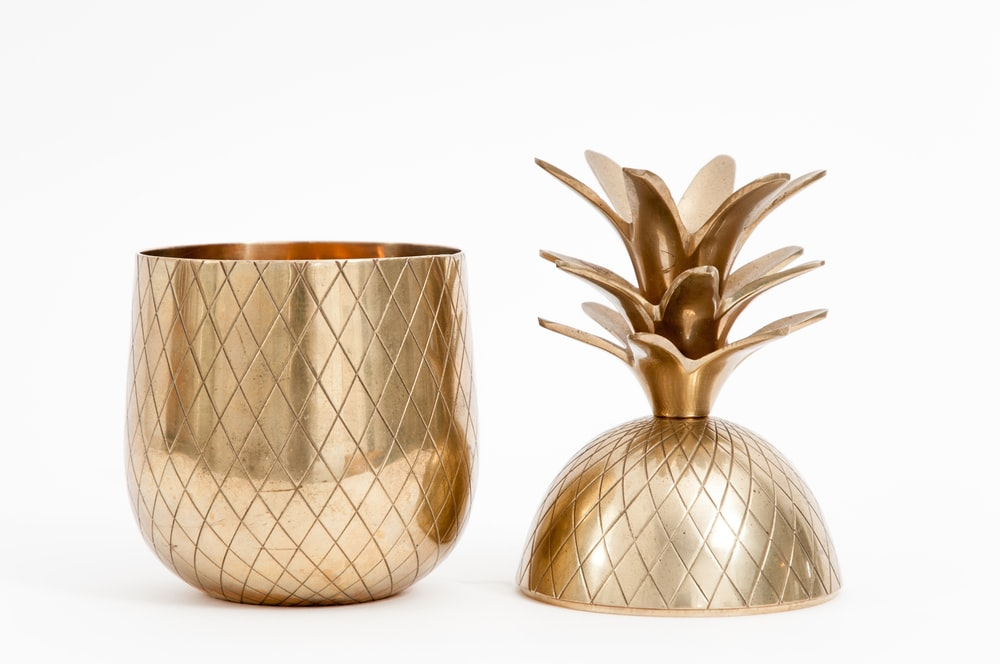 gold-colored pineapple container