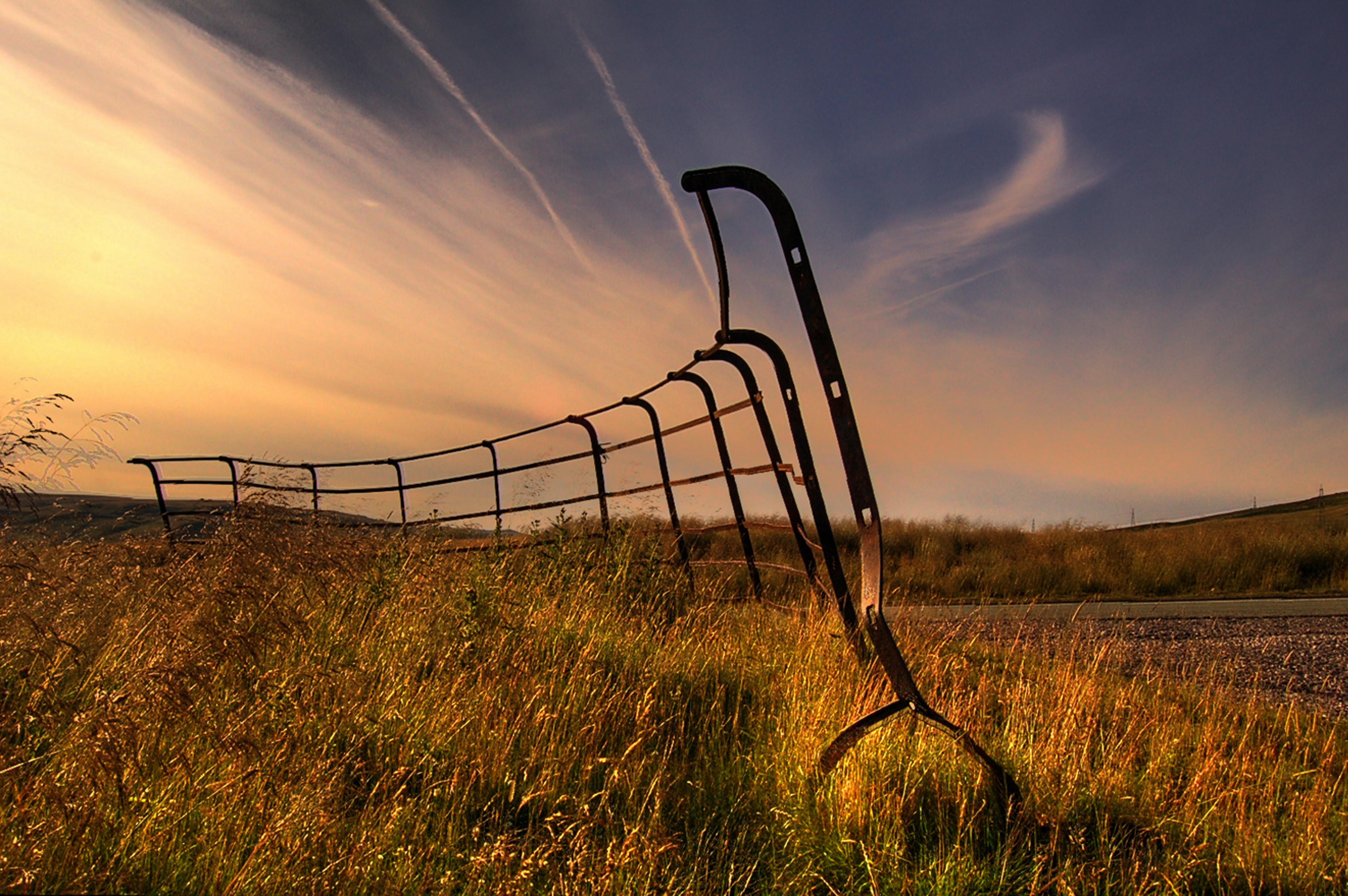 black steel fence on green grass field