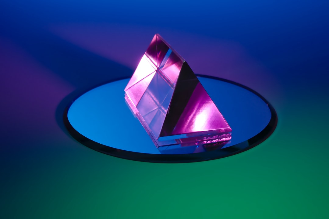 Photograph of a prism and a mirror.  As Graphic as this looks, there is very little post-processing involved!  Check my collection of similar photos on Unsplash in my FLASH AND COLOR collection here: https://unsplash.com/collections/4365614/flash-and-color-by-lazy-creek
