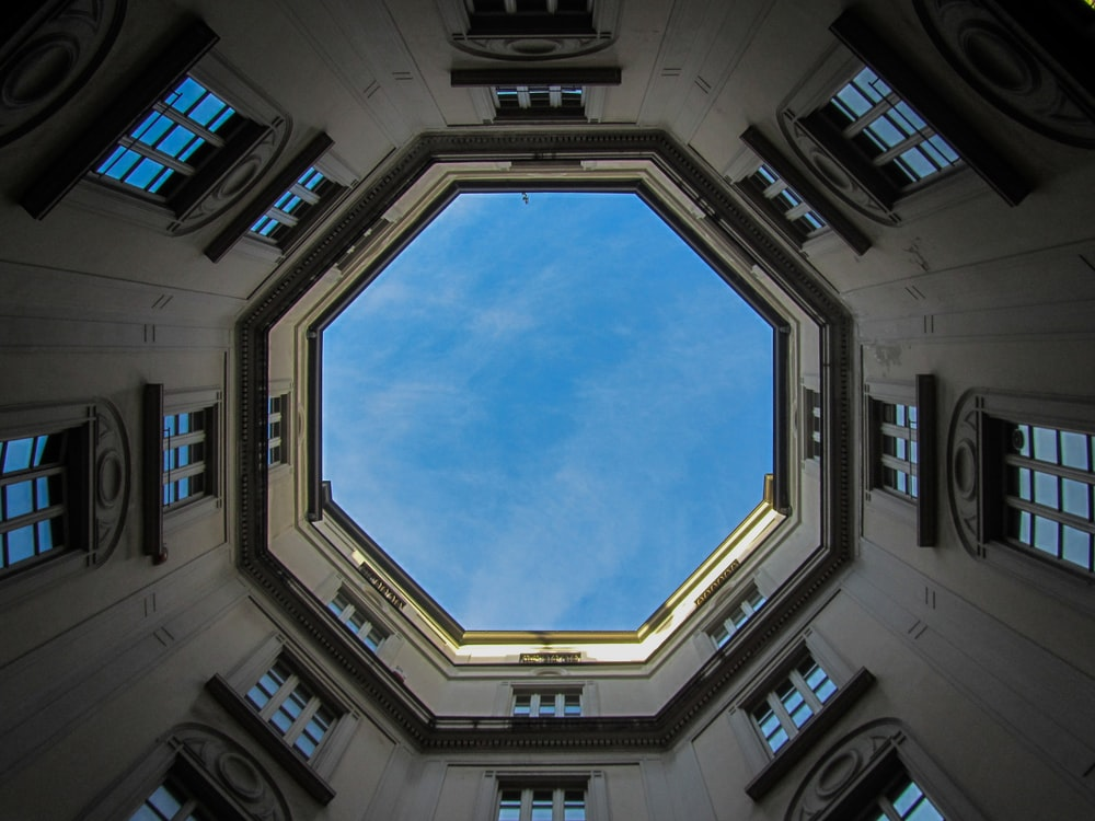 low-angle photography of concrete octagonal building during daytime