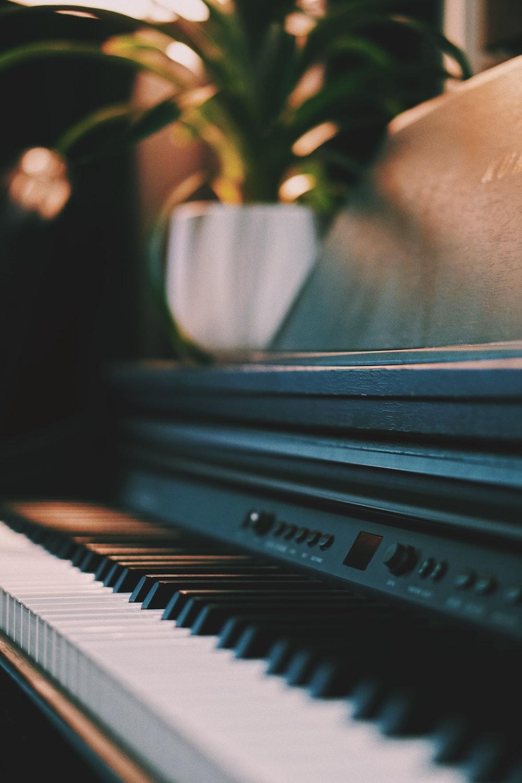 closeup photography of upright piano