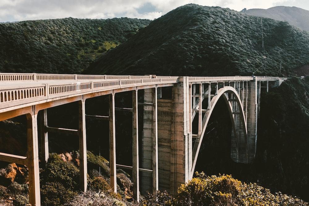 concrete bridge near mountains