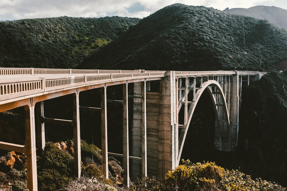 concrete bridge near mountains