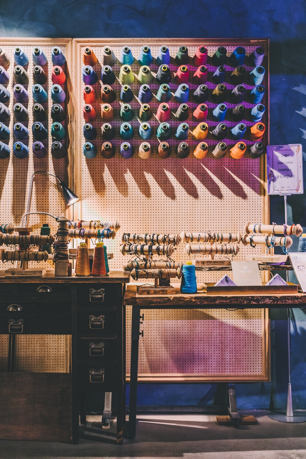 assorted-color sewing threads on organizer rack