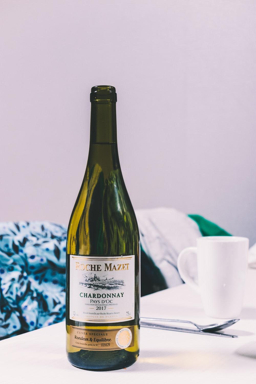 opened chardonnay bottle on table