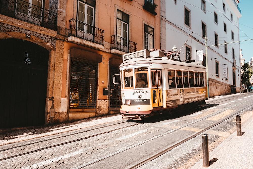 white tram running on the city