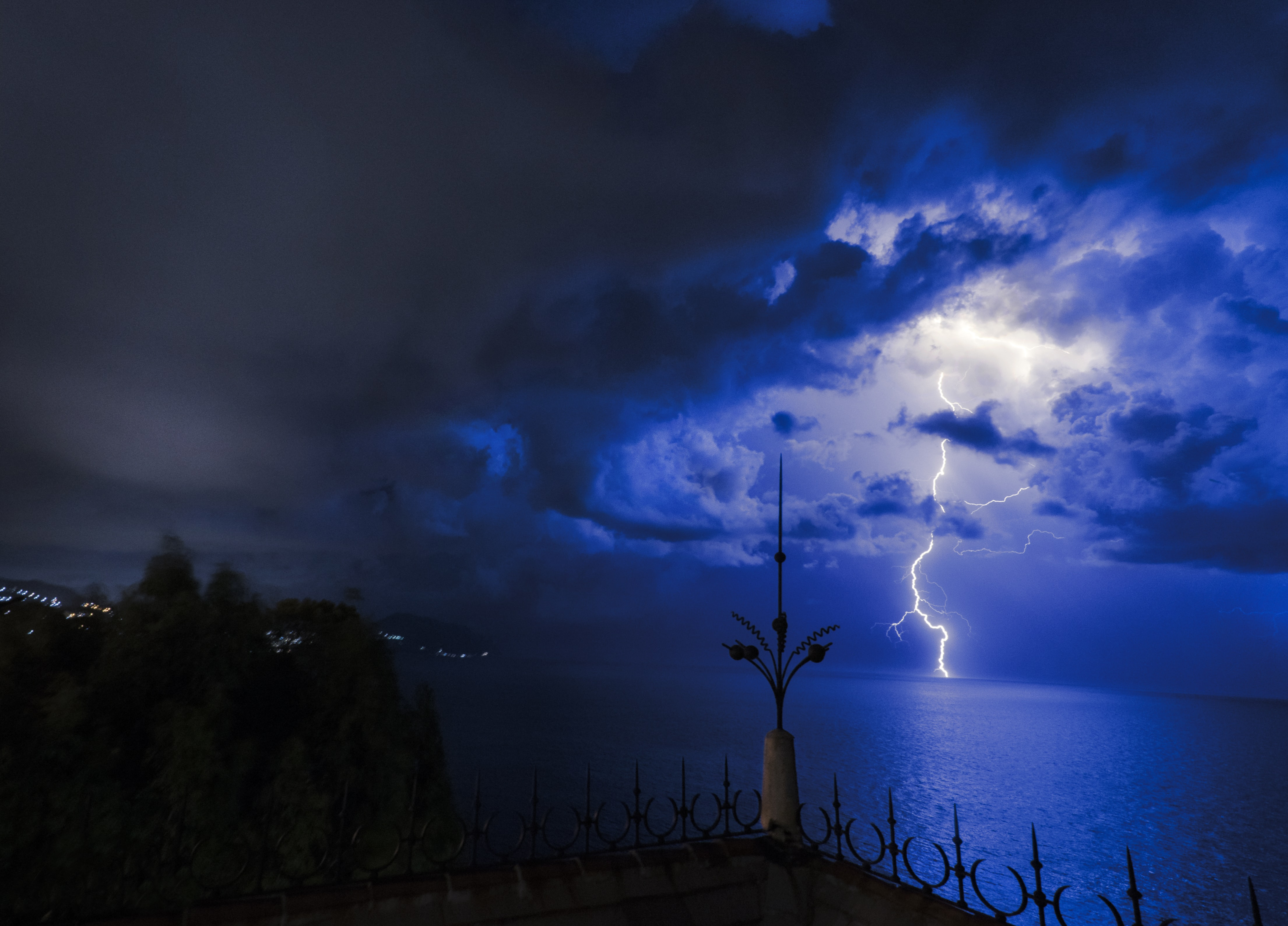 lightning hit on the sea during night