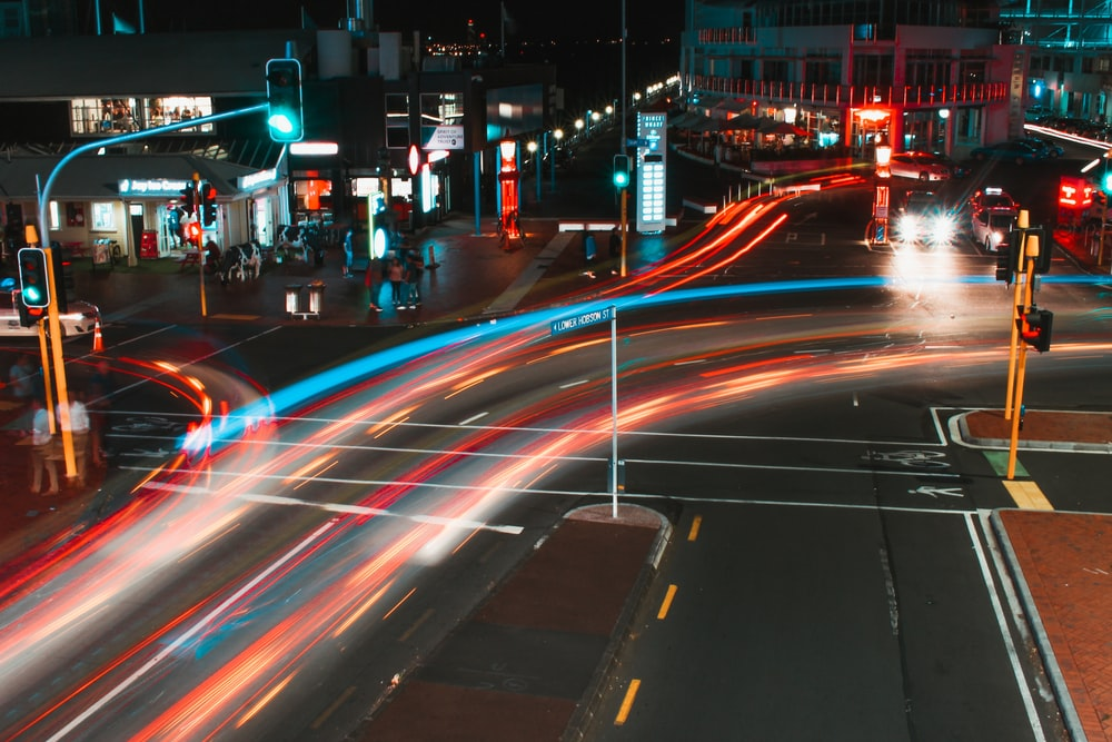 time lapse photograph of vehicles running on road