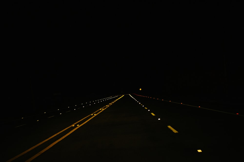 black concrete road during nighttime