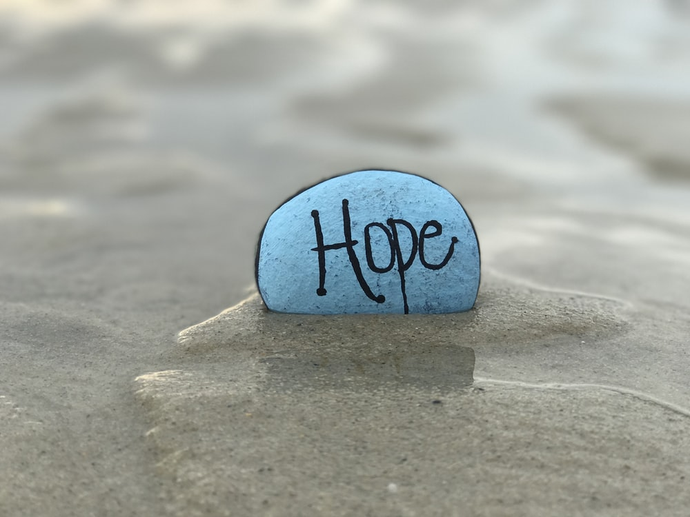 gray hope-printed stone in