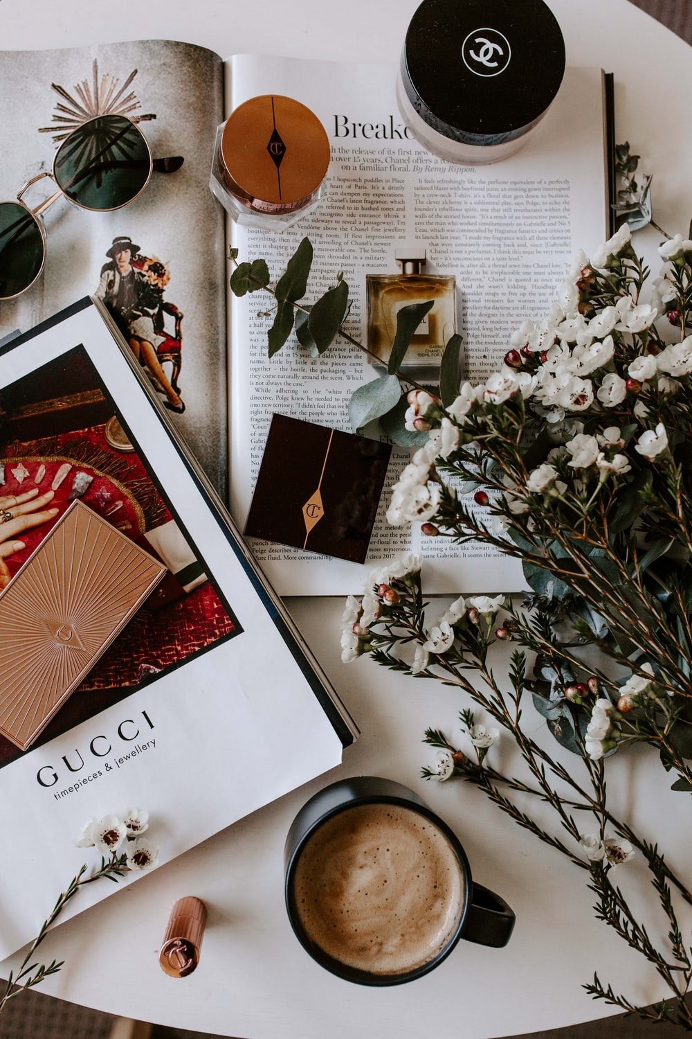 flat lay photography of coffee and book