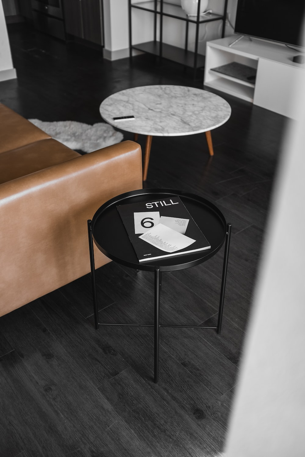 Outstanding Round White And Black Wooden Tables Beside Brown Leather Squirreltailoven Fun Painted Chair Ideas Images Squirreltailovenorg