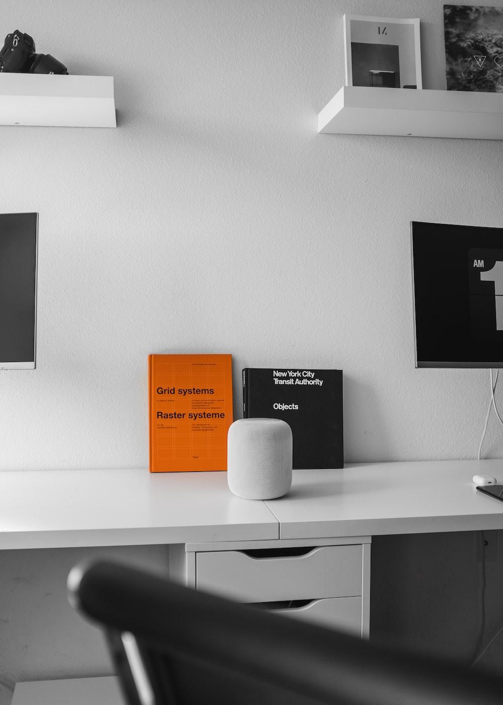 gray speaker on white table