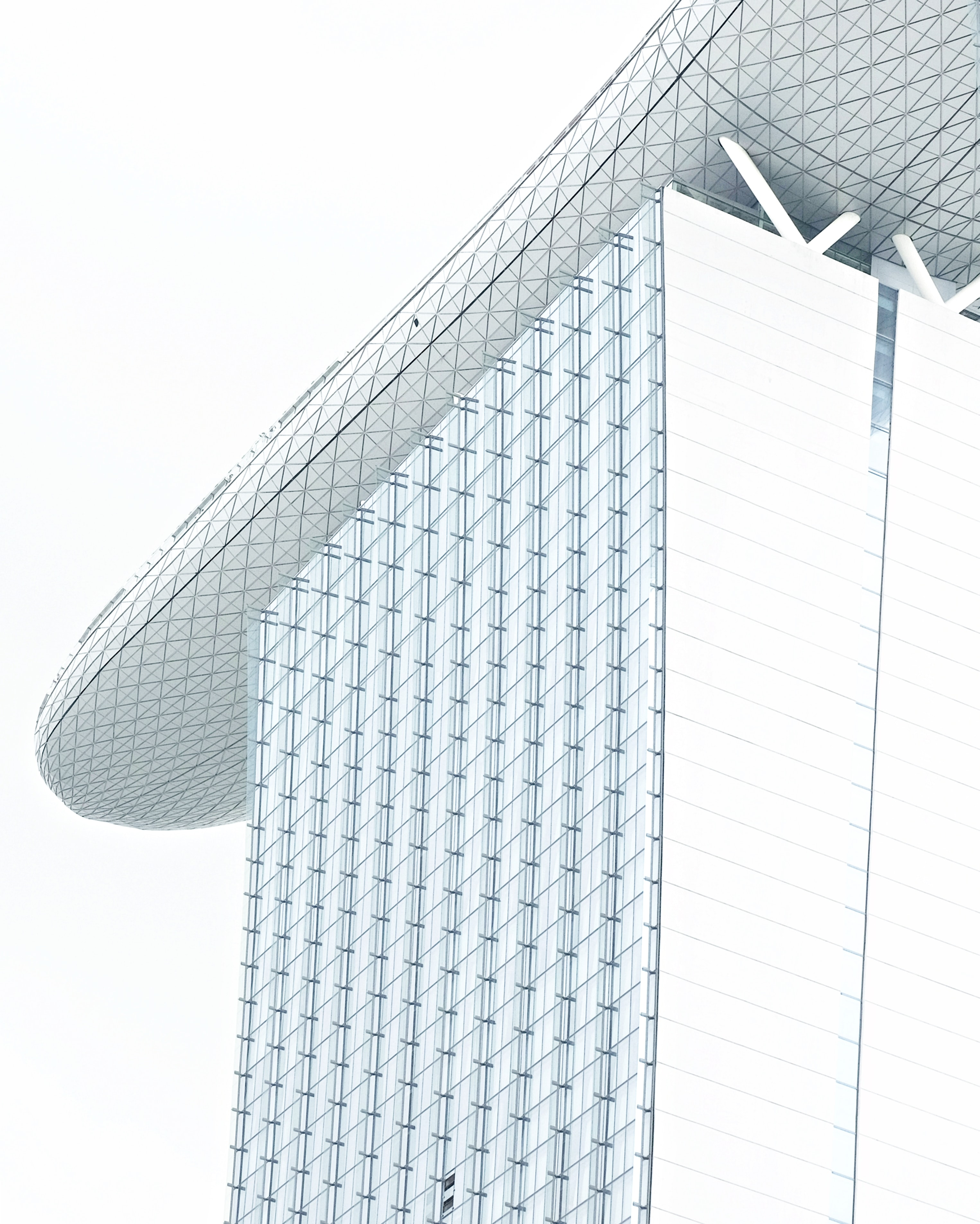 glass building under white clouds