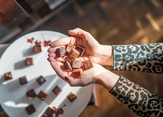 person holding chocolates at daytime