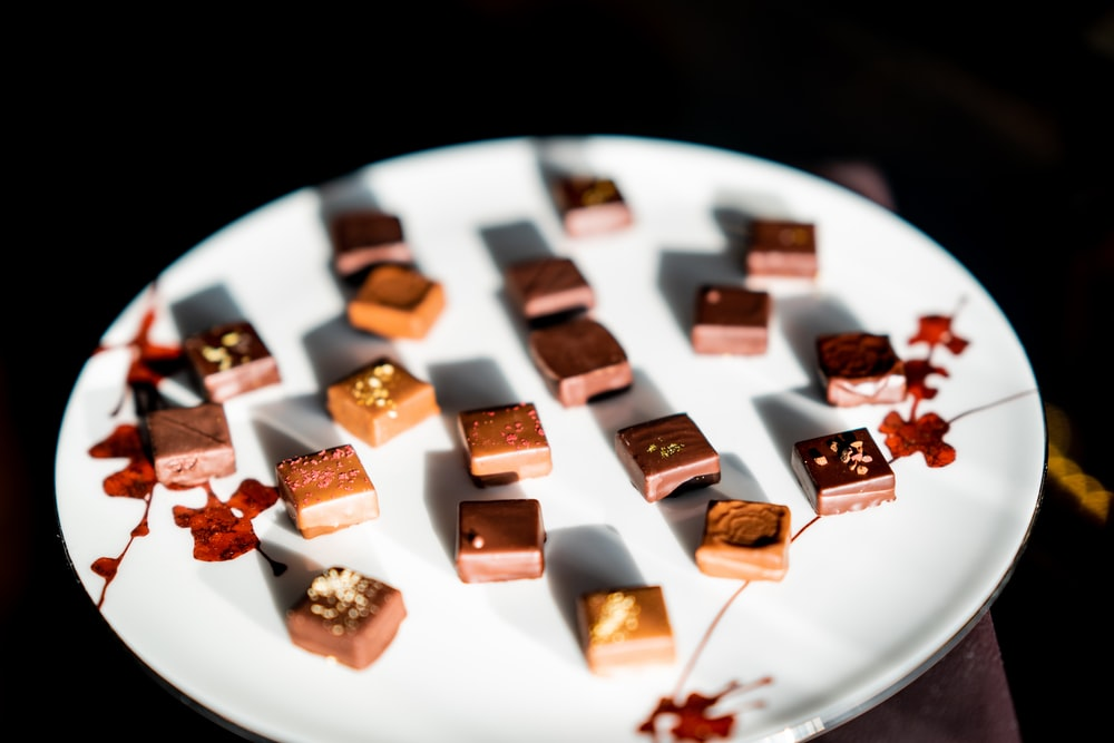 cube chocolates on round white ceramic plate