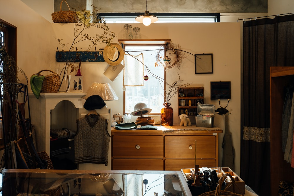 brown wooden cabinet in room with lights turned-on