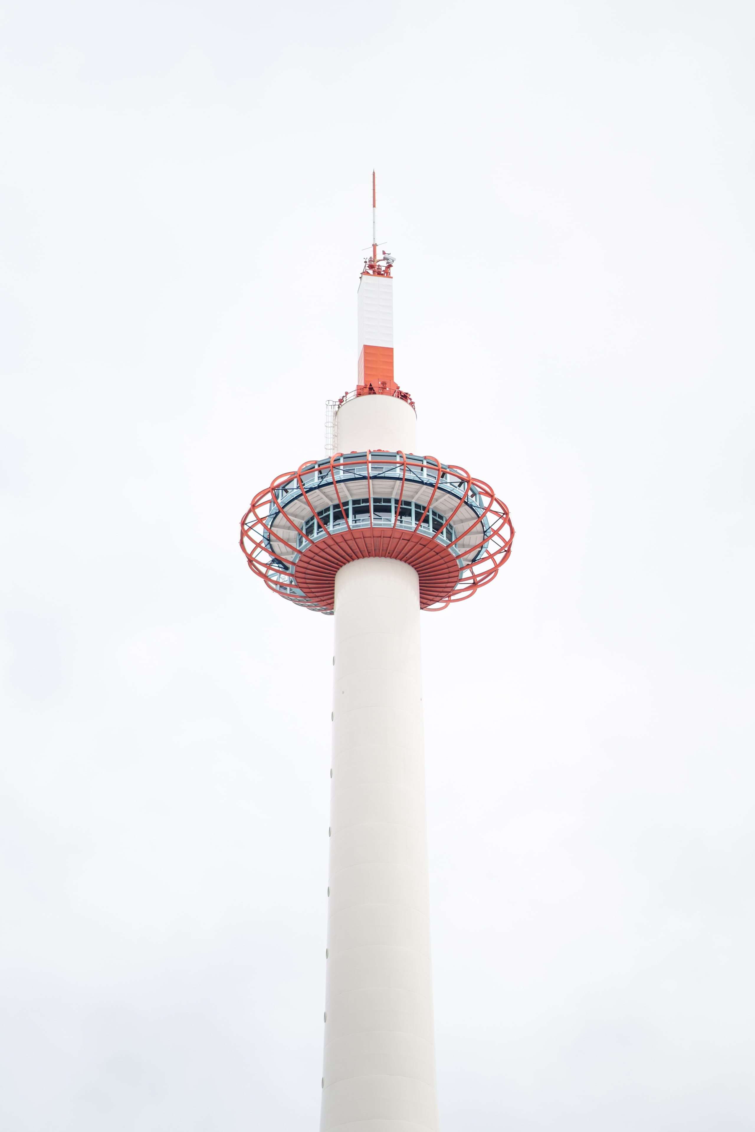 low-angle photography of white and red tower