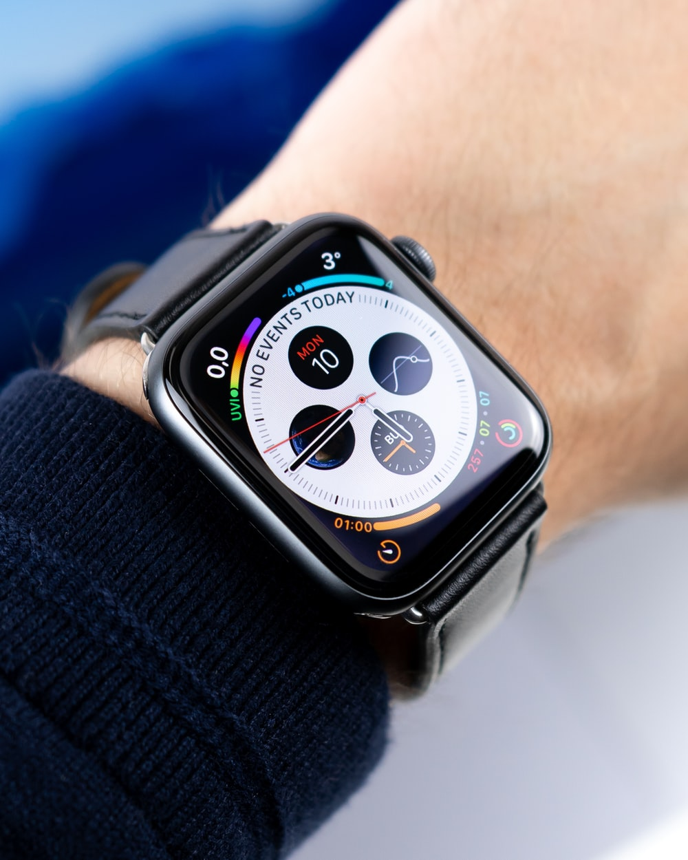 space gray Apple watch with black leather strap