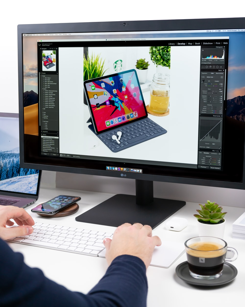 person using computer setup on white desk