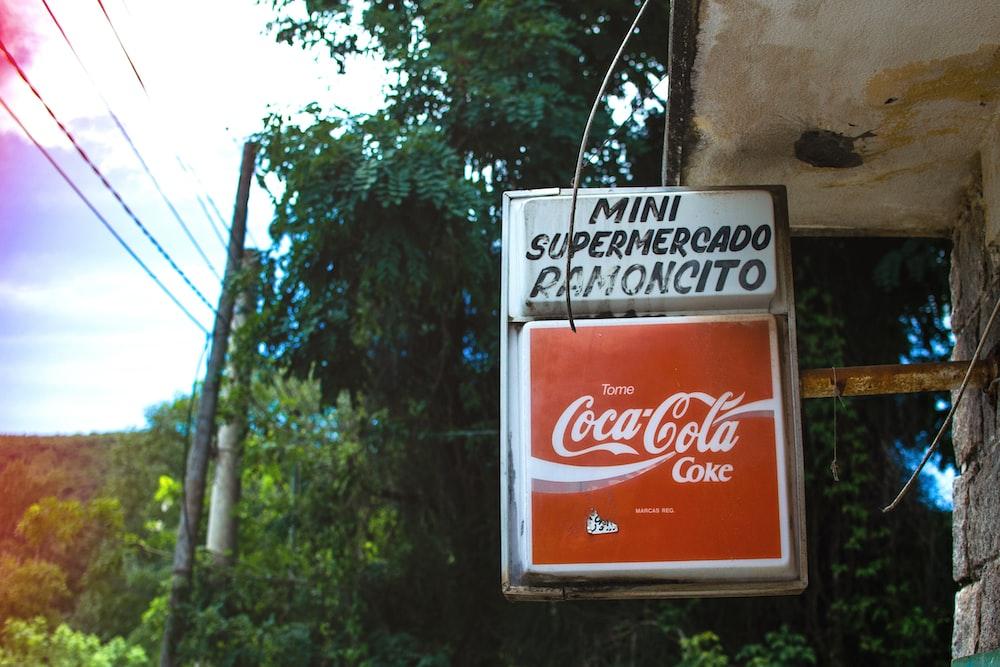 Coca-Cola signage on focus photography
