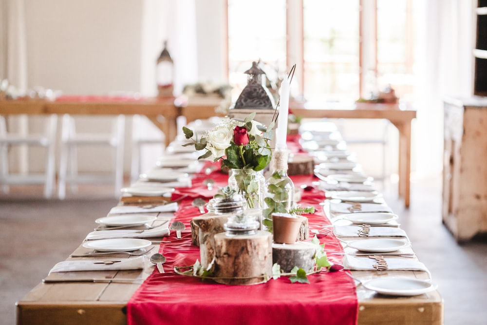 long table with plates and spoon set up