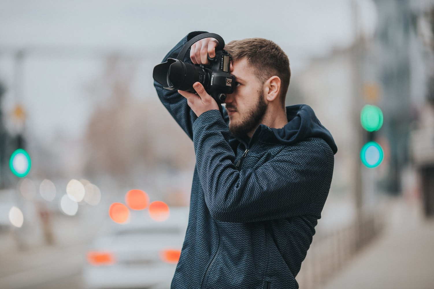 Man using a black dlsr camera