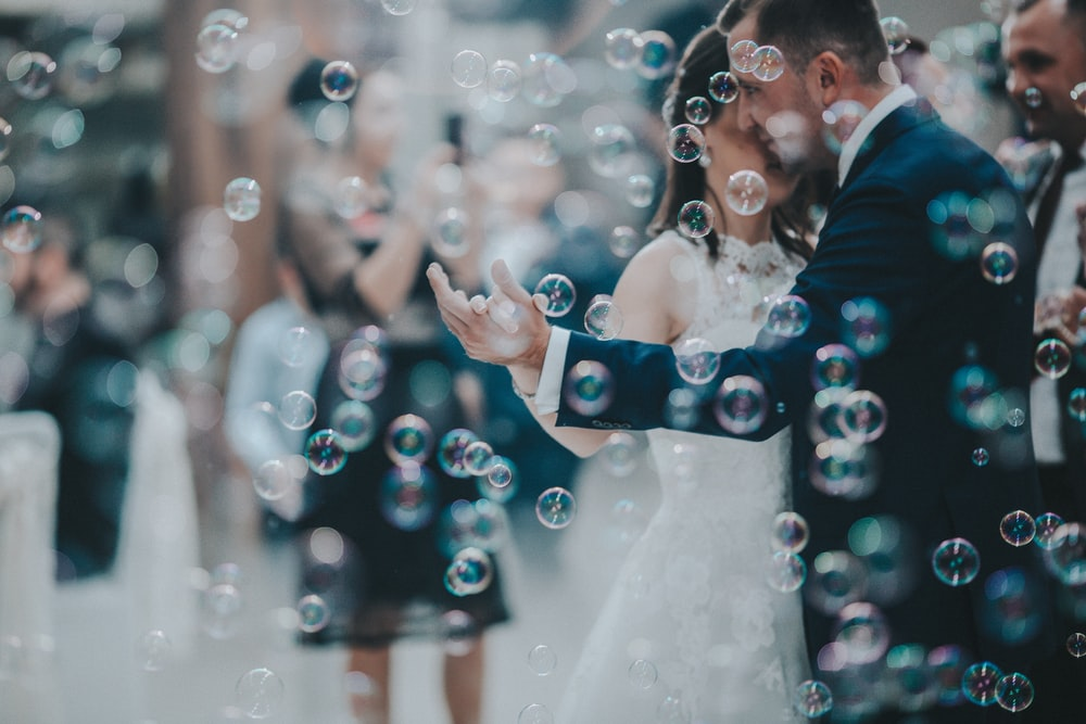 wedding couple dancing with bubbles
