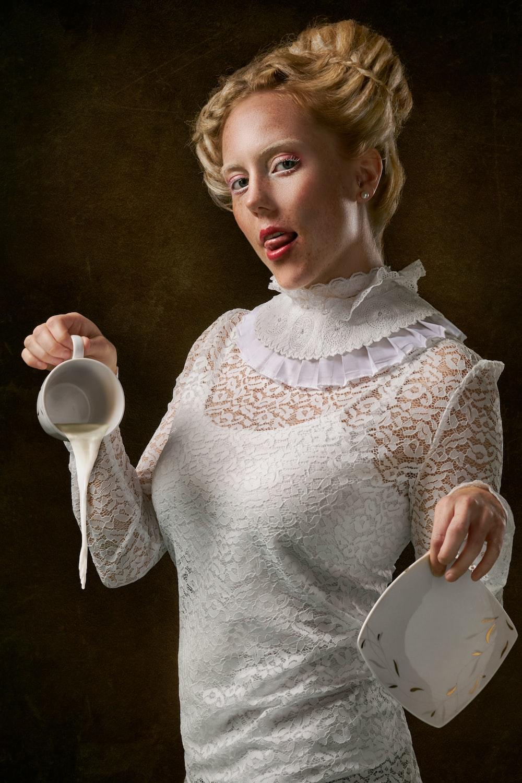 woman wearing white long-sleeved shirt holding ceramic mug