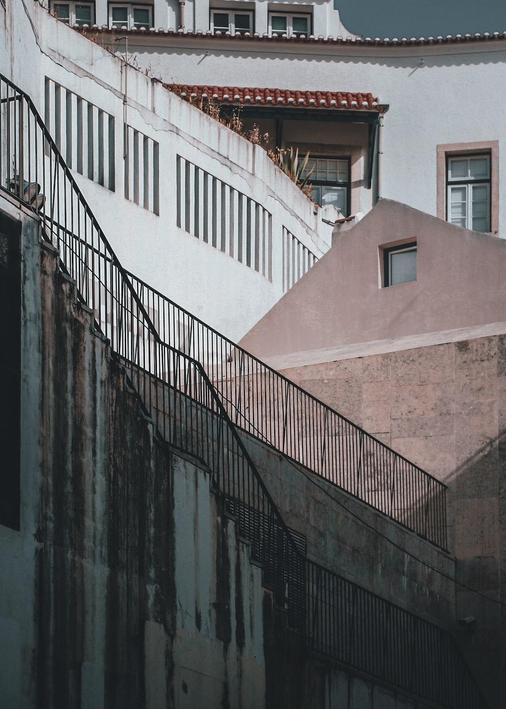 black metal railings beside white painted building