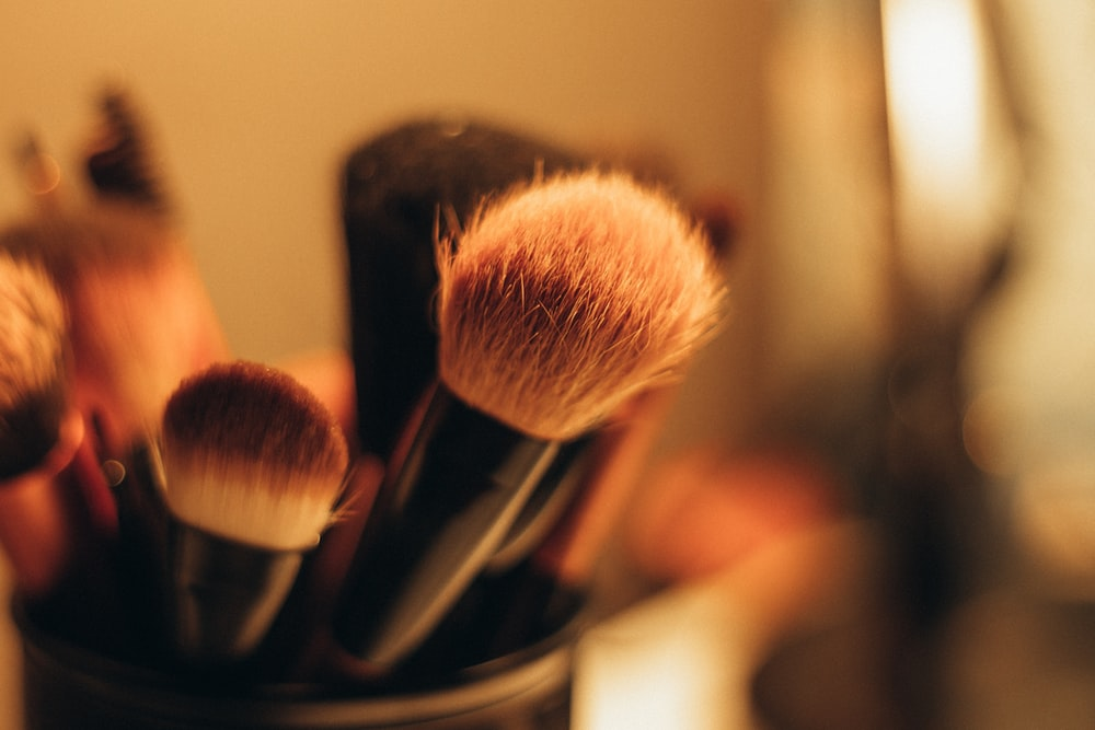 makeup brushes on black organizer